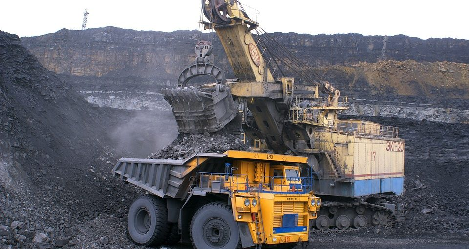 Caterpillar trucks hauling coal